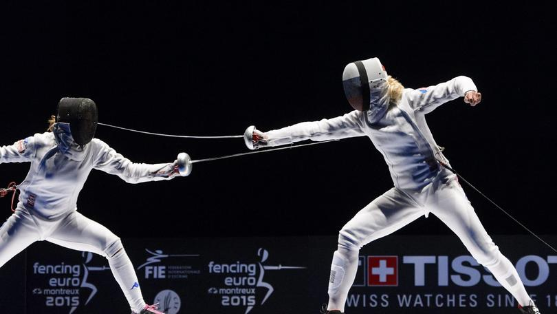 epa04786586 Rossella Fiamingo (L) of Italy competes against Violetta Kolobova of Russia during the Women's individual epee final at the European Fencing Championships in Montreux, Switzerland, 06 June 2015.  EPA/JEAN-CHRISTOPHE BOTT
